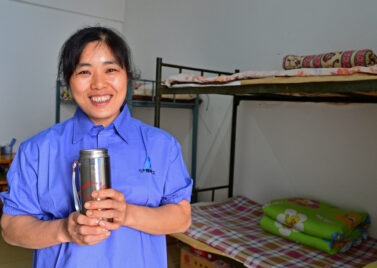 A Chinese migrant worker in her dormitory [source: World Bank Photo Collection]