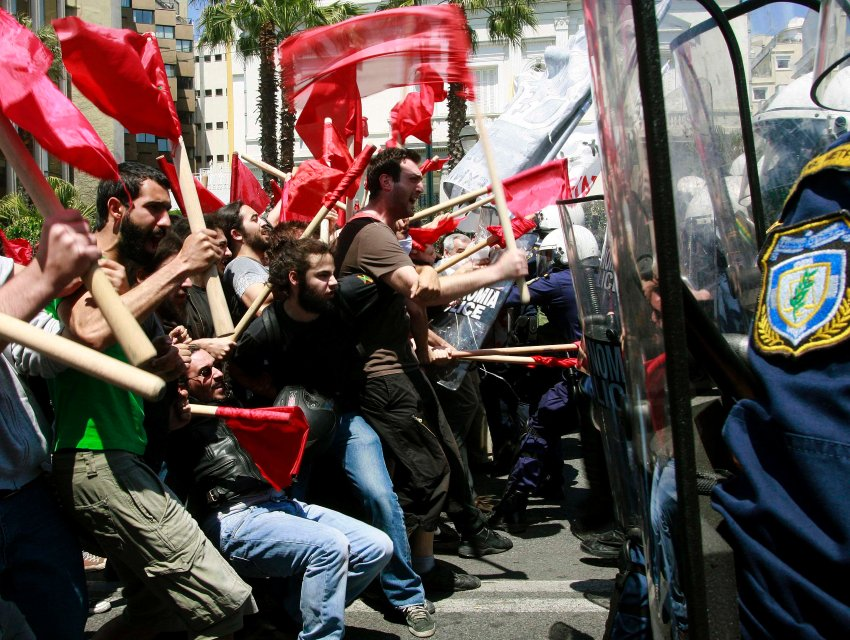 Protesters clash with policemen during riots at a May Day rally in Athens, 2010 (Source: Flickr: Joanna)