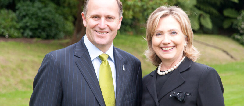 "The ""smiling assassin"" John Key meets then US Secretary of State Hillary Clinton"