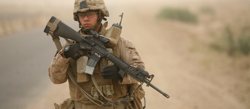 A US Marine in Anbar, conducting a security patrol around combat outpost Viking, Iraq, in 2009